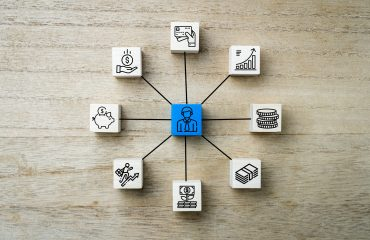 Personal money, finance and buisness icons or symbold on wooden square blocks